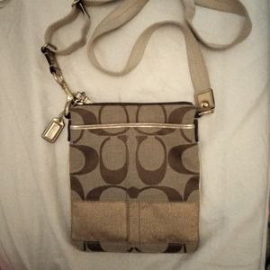 COACH Gently used messenger bag in tan/gold